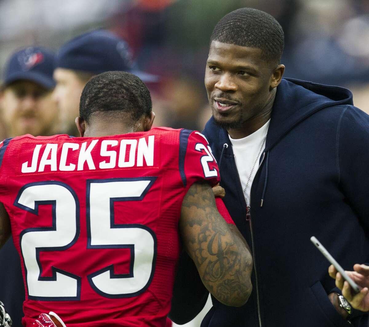 Houston Texans cornerback Kareem Jackson (25) embraces former Texans wide receiver Andre Johnson before an NFL football game against the Jacksonville Jaguars at NRG Stadium on Sunday, Dec. 18, 2016, in Houston. ( Brett Coomer / Houston Chronicle )