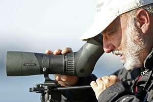 Ed Vine searches for waterfowl during Christmas bird survey in Berkeley, Calif., on December 18, 2016.