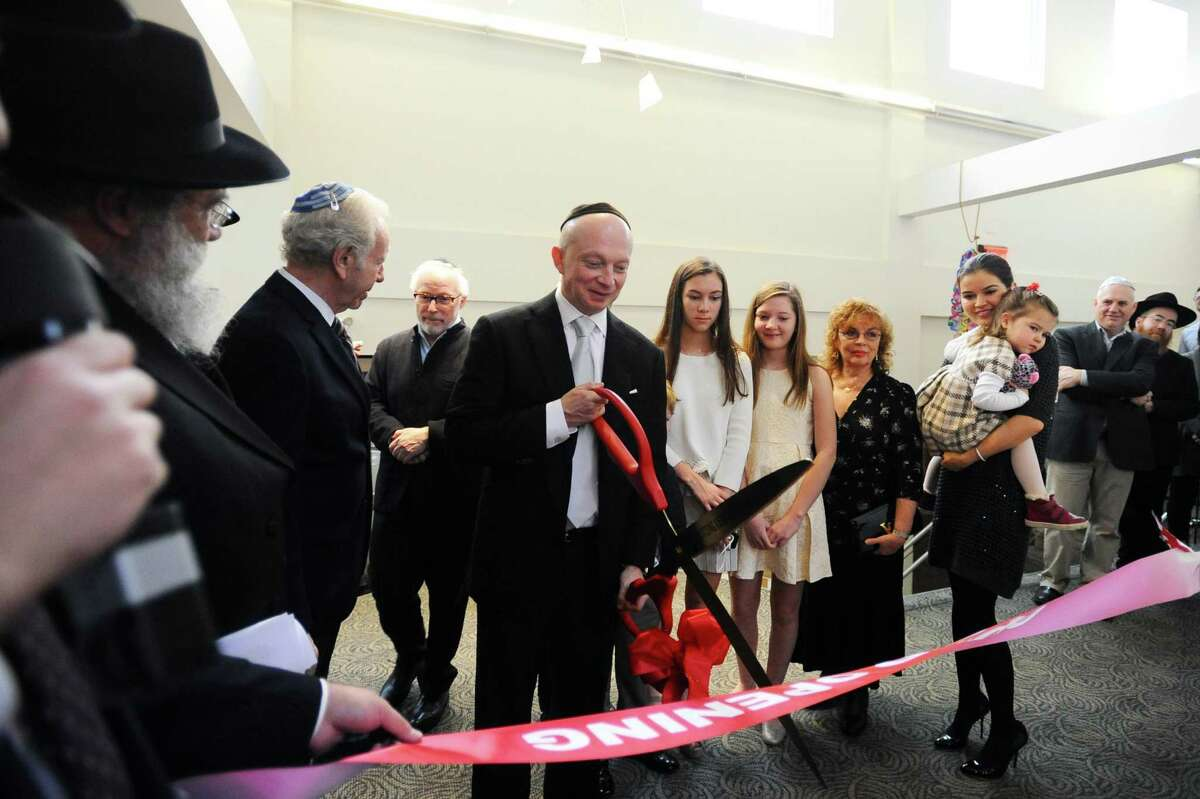 Igor Tulchinsky, CEO of Worldquant, a quantitative investment management firm based in Greenwich, cuts the dedication ribbon during a ceremony at the Chabad Lubavitch Center of Greater Stamford in Stamford on Sunday.
