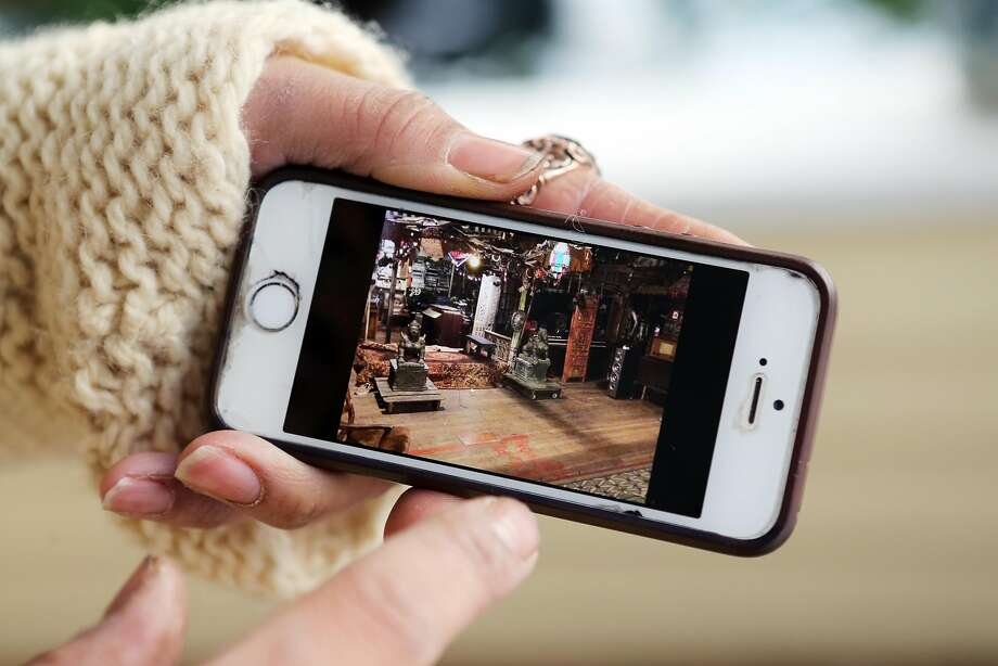 Aaron Marin said, shows photographs on his phone he took from inside the Ghost Ship. Photo: Thomas Patterson, Special To The Chronicle