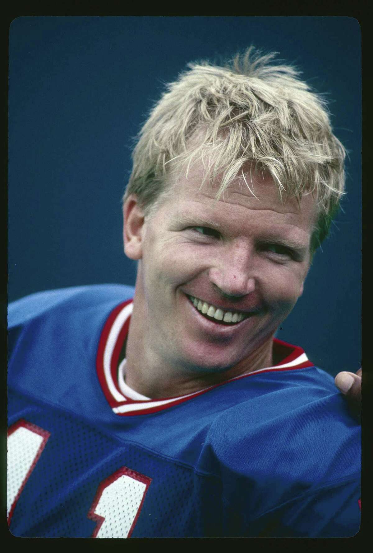 EAST RUTHERFORD, NJ - CIRCA 1980's: Quarterback Phil Simms #11 of the New York Giants on the sidelines during a circa 1980's NFL football game at Giant Stadium in East Rutherford, New Jersey. Simms played for the Giants from 1979-93. (Photo by Focus on Sport/Getty Images)