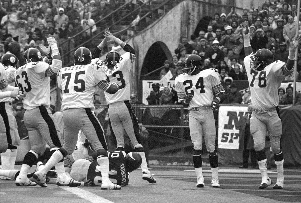 ** FILE ** The Pittsburgh Steelers defense react as Minnesota Vikings' quarterback Fran Tarkenton (10) recovers his own fumble in the end zone for a safety in second quarter of Super Bowl IX in New Orleans at Tulane Stadium, in this Jan. 12, 1975 photo. Identifiable players are Steelers' Ernie Holmes (63), Joe Greene (75), and Mike Wagner (23). The Steelers won 16-6. They remain the only NFL team to win four Super Bowls in six years, yet what might separate the Steel Curtain Steelers of the 1970s from other NFL champions is what they did off the football field. (AP Photo/Charlie Kelly)