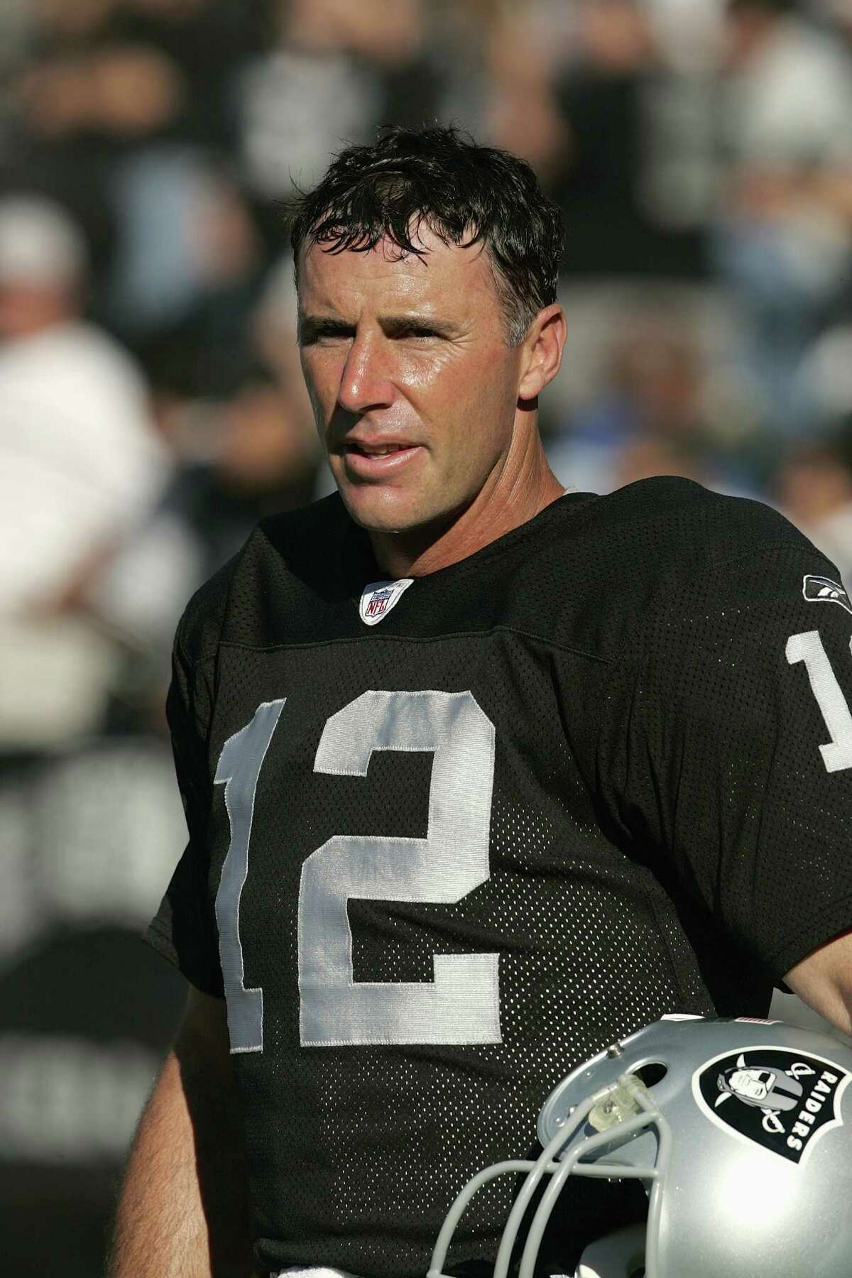 OAKLAND CA - AUGUST 21: Quarterback Rich Gannon #12 of the Oakland Raiders looks on from the sideline before the preseason NFL game against the Dallas Cowboys at Network Associates Coliseum on August 21, 2004 in Oakland California. The Cowboys defeated the Raiders 21-20. (Photo by David Paul Morris/Getty Images)