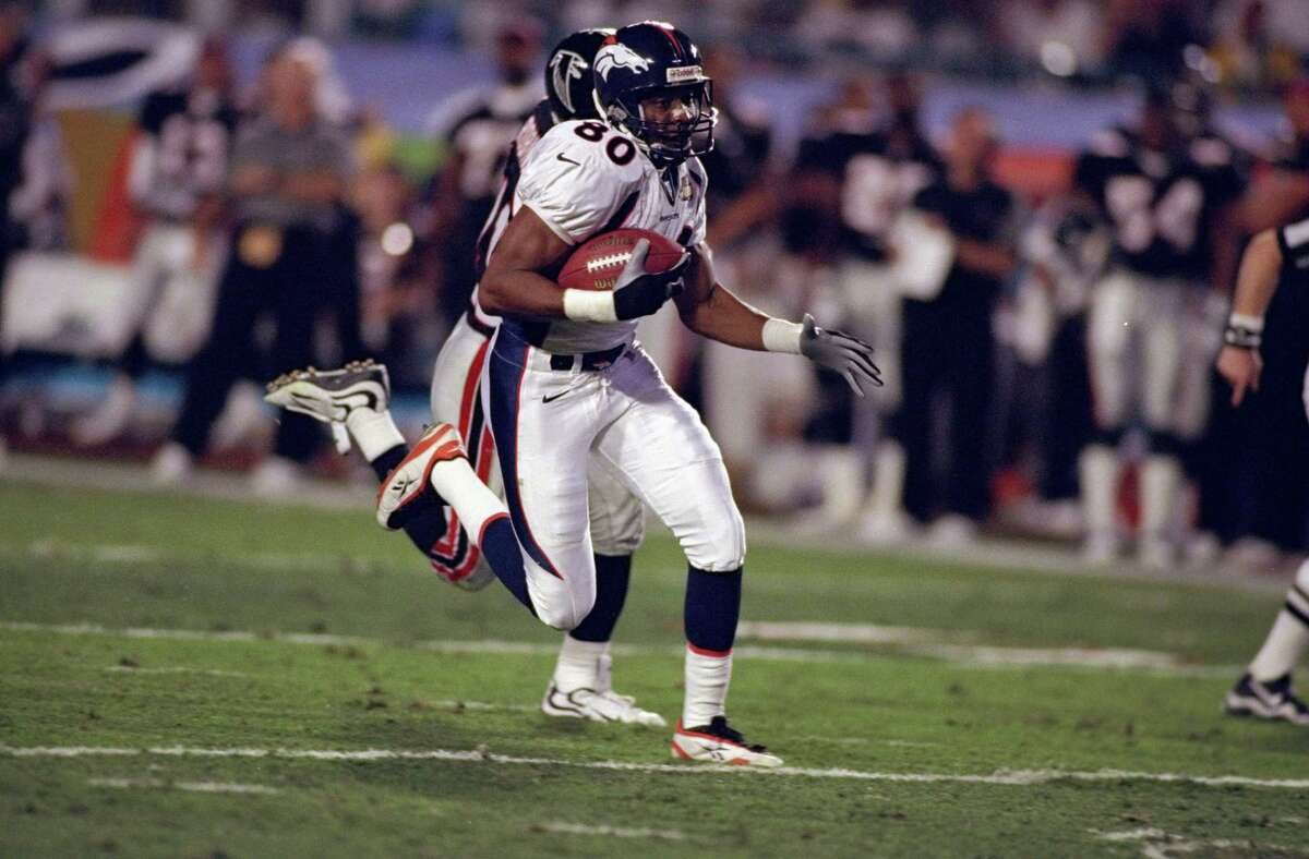 31 Jan 1999: Rod Smith #80 of the Denver Broncos scoring a touch down with Eugene Robinson #41 chacing him during the Super Bowl XXXIII Game against the Atlanta Falcons at the Pro Player Stadium in Miami, Florida. The Broncos defeated the Falcons 34-19.