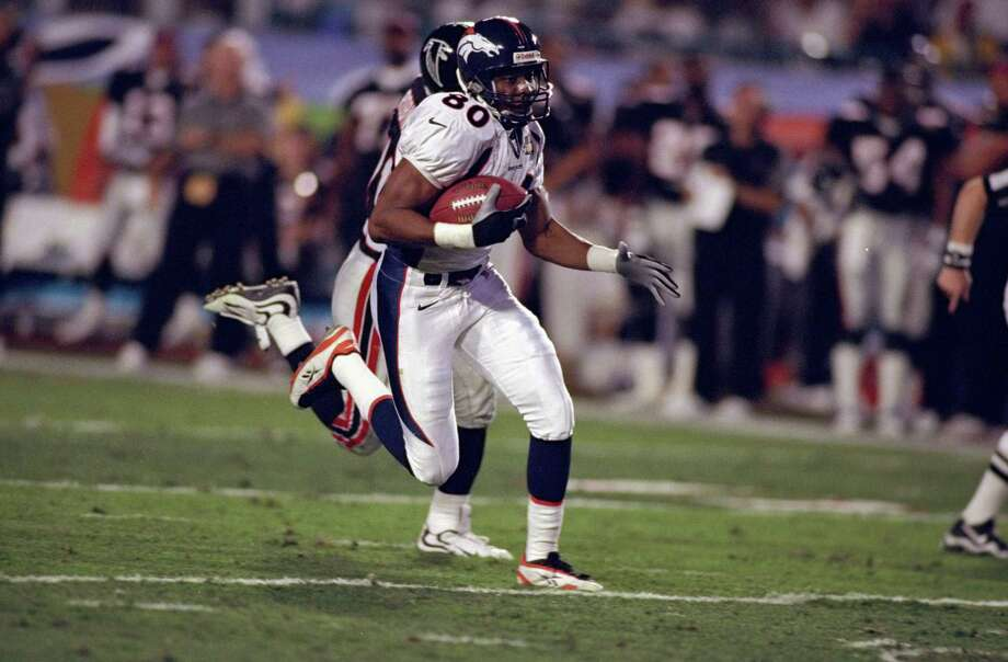 31 Jan 1999:  Rod Smith #80 of the Denver Broncos scoring a touch down with Eugene Robinson #41 chacing him during the Super Bowl XXXIII Game against the Atlanta Falcons at the Pro Player Stadium in Miami, Florida. The Broncos defeated the Falcons 34-19. Photo: Al Bello, Staff / This content is subject to copyright.