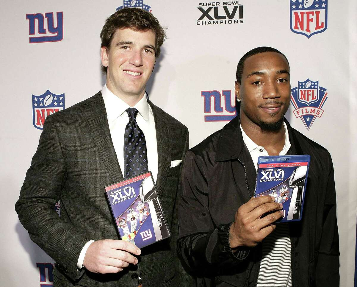 """NEW YORK, NY - MARCH 05: NY Giants Eli Manning and Mario Manningham attend the Super Bowl XLVI Champions: New York Giants """"Blue Carpet"""" VIP premiere at the Regal E-Walk Stadium 13 on March 5, 2012 in New York City. (Photo by John Lamparski/WireImage)"""