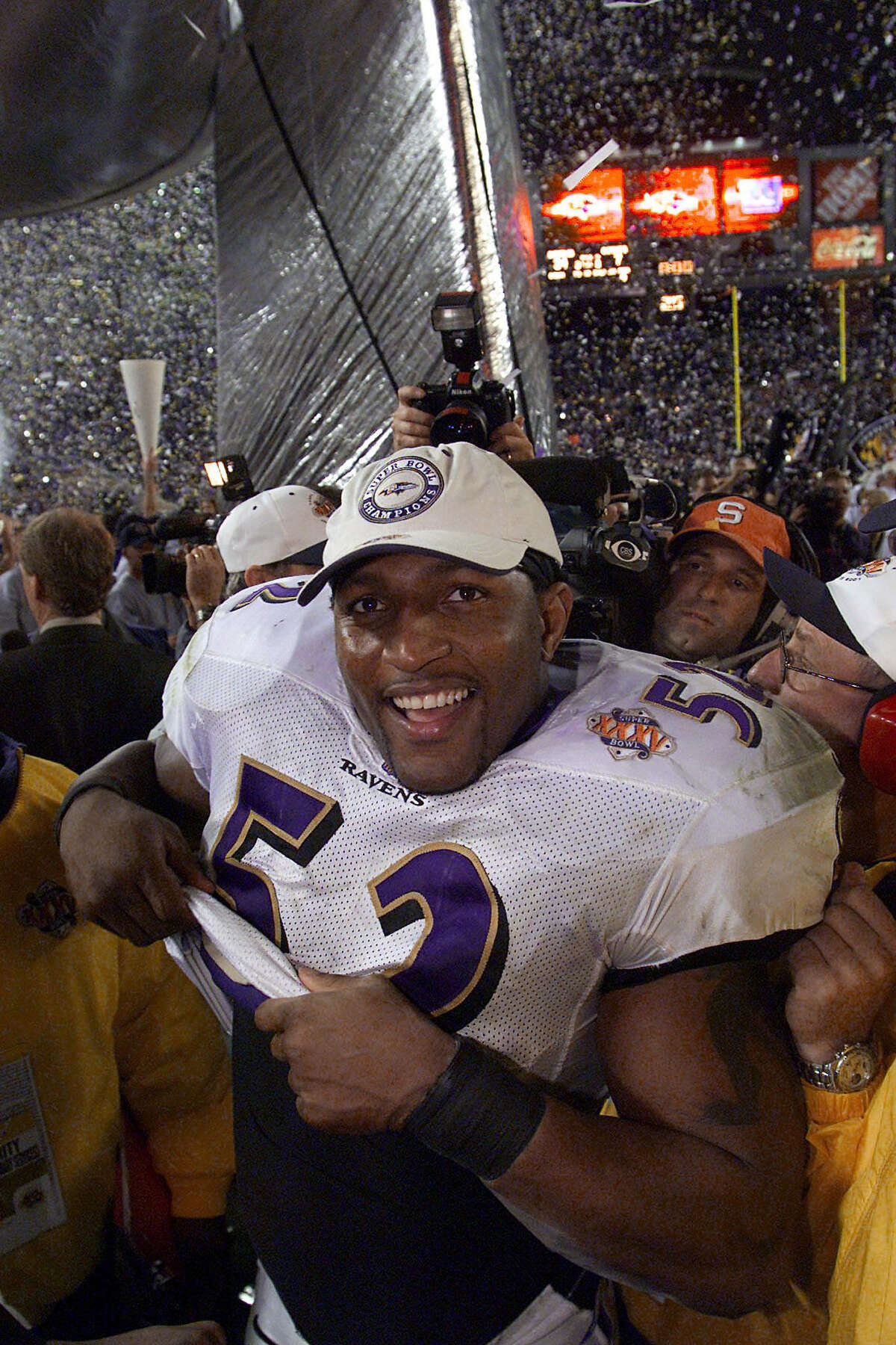 TAMPA, UNITED STATES: Ray Lewis of the Baltimore Ravens smiles after the Ravens defeated the New York Giants 34-7 in Super Bowl XXXV 28 January 2001 at Raymond James Stadium in Tampa, Florida. Lewis was named Most Valuable Player (MVP) in the Ravens victory for the NFL championship. AFP PHOTO/Jeff HAYNES (Photo credit should read JEFF HAYNES/AFP/Getty Images)