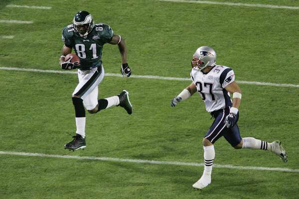 JACKSONVILLE, FLORIDA - FEBRUARY 06:  Wide receiver Terrell Owens #81 of the Philadelphia Eagles runs with the ball after catching a 30-yard pass against Rodney Harrison #37 of the New England Patriots in the first quarter of Super Bowl XXXIX at Alltel Stadium on February 6, 2005 in Jacksonville, Florida.  (Photo by Al Bello/Getty Images)