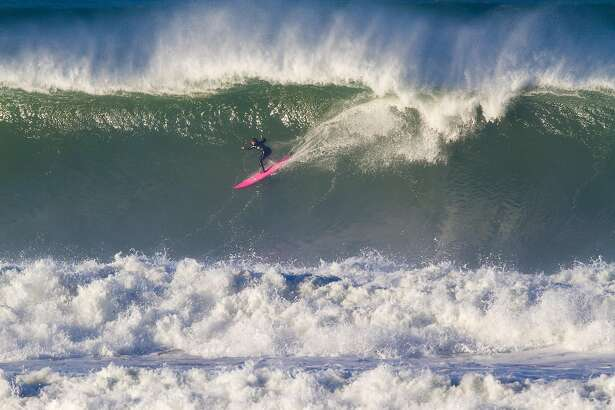 Bianca Valenti drops into a big wave at Ocean Beach on December 1, 2015.