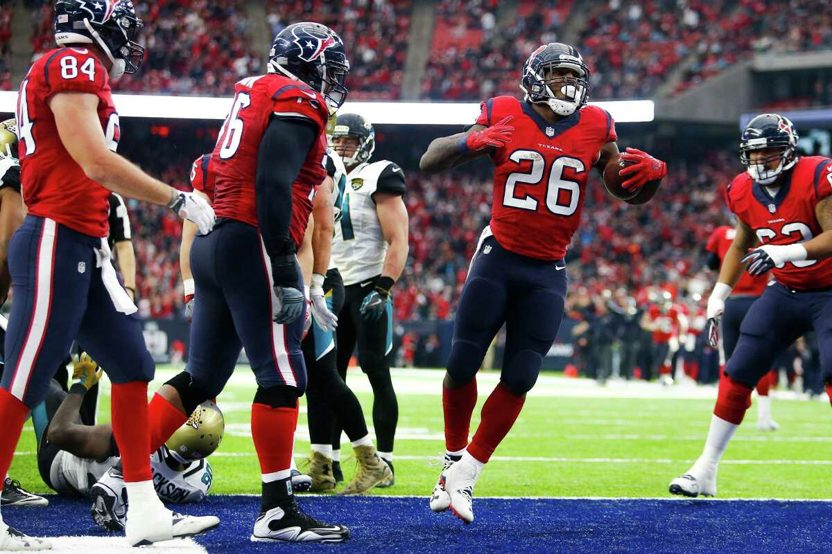 Texans running back Lamar Miller (26) celebrates after rushing for the team's only touchdown in the 21-20 win over Jacksonville at NRG Stadium on Sunday. Miller hurt his ankle during the final minutes of the game but the injury was characterized as minor.