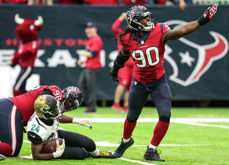 The Texans' Jadeveon Clowney (90) is pumped after teaming with D.J. Reader to tackle Jags tailback T.J. Yeldon (24) for a fourth-quarter loss. Clowney, who played linebacker Sunday, finished with a sack, three tackles for loss, two QB hits, and a pass breakup. Photo: Brett Coomer, Staff / © 2016 Houston Chronicle