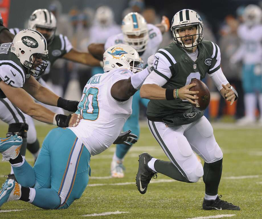 New York Jets quarterback Bryce Petty (9) tries to avoid Miami Dolphins defensive tackle Earl Mitchell (90) during the fourth quarter of an NFL football game, Saturday, Dec. 17, 2016, in East Rutherford, N.J. (AP Photo/Bill Kostroun) Photo: Bill Kostroun, Associated Press