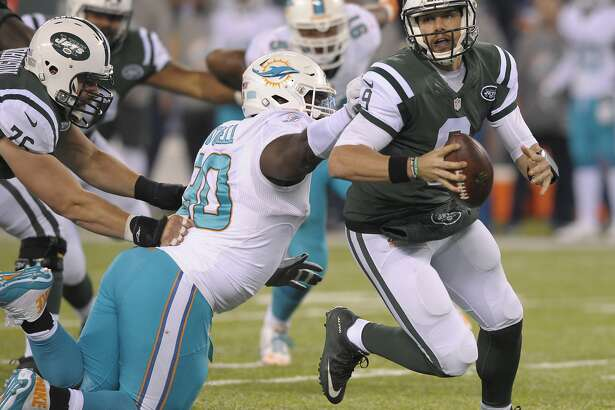 New York Jets quarterback Bryce Petty (9) tries to avoid Miami Dolphins defensive tackle Earl Mitchell (90) during the fourth quarter of an NFL football game, Saturday, Dec. 17, 2016, in East Rutherford, N.J. (AP Photo/Bill Kostroun)