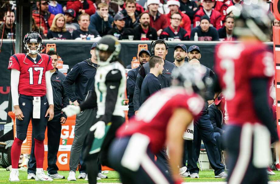 With the game on the line in the fourth quarter Sunday, quarterback Brock Osweiler (17) could merely watch from the sidelines as Tom Savage directed the Texans' offense. Photo: Brett Coomer, Staff / © 2016 Houston Chronicle