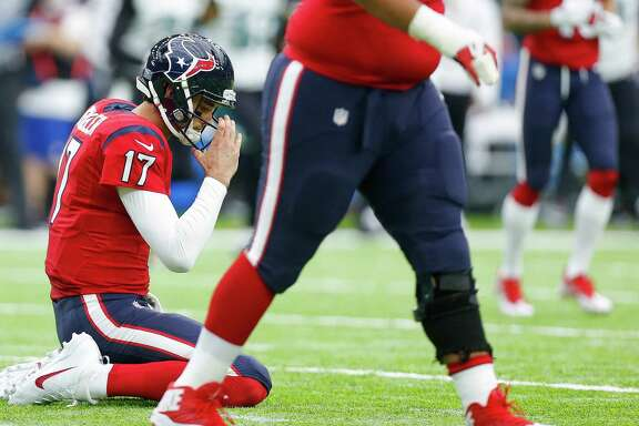 The Jaguars brought Texans quarterback Brock Osweiler to his knees after intercepting him for the second time Sunday. For the season, he has thrown 16 picks and 14 touchdown passes.