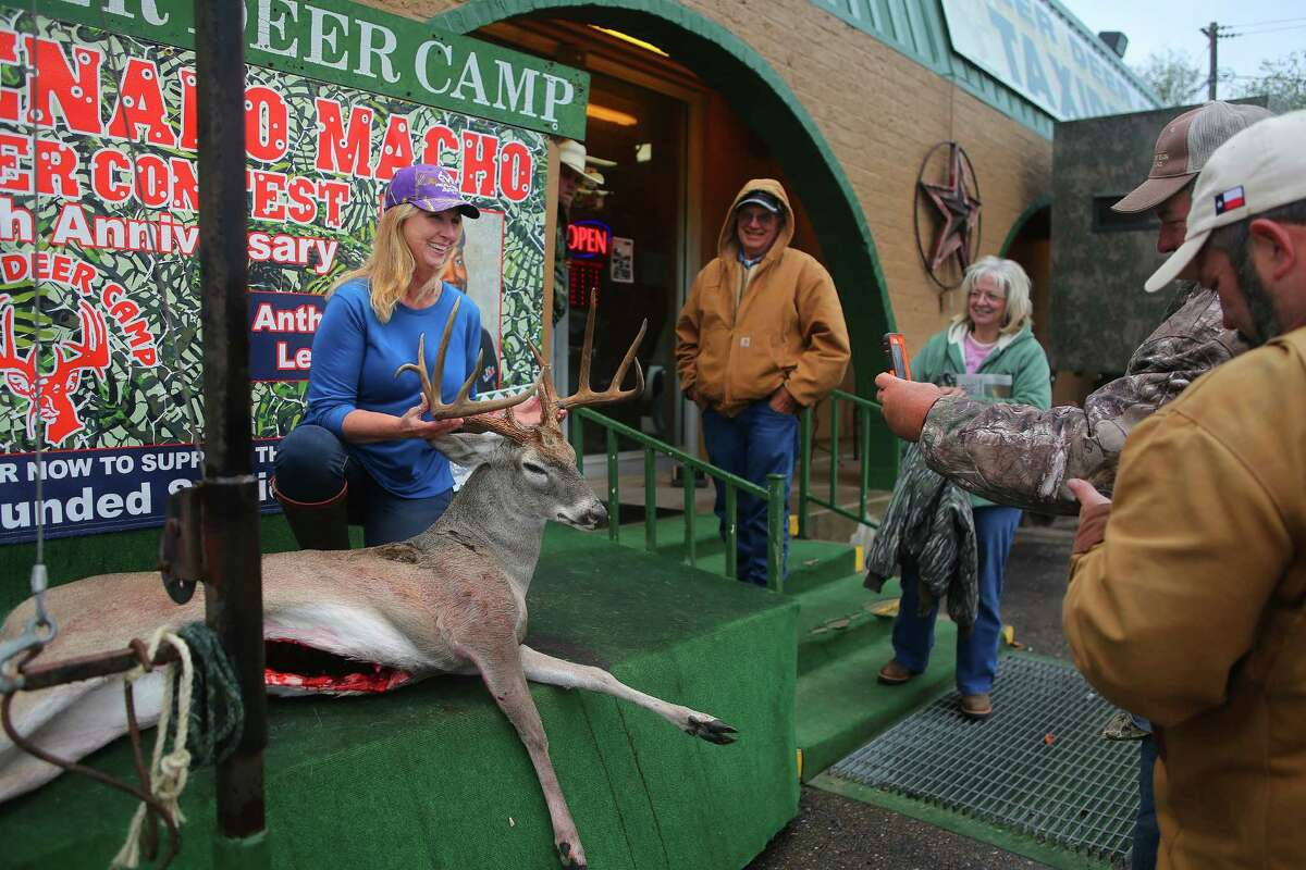 Geneva Rader, of Angelton, holds up a deer she is entering in the Freer Deer Camp's contest, Thursday, Dec. 8, 2016, in Houston. The popularity of deer hunting is a large part of the local economy around Freer. ( Mark Mulligan / Houston Chronicle )