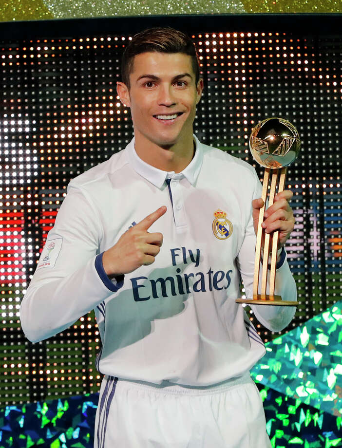 Real Madrid's Cristiano Ronaldo celebrates as he holds the golden ball award for the most goals after winning the final of the FIFA Club World Cup soccer tournament in Yokohama, near Tokyo, Sunday, Dec. 18, 2016.(AP Photo/Shuji Kajiyama) Photo: Shuji Kajiyama, STF / Copyright 2016 The Associated Press. All rights reserved.