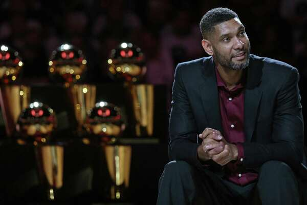 Former Spurs standout Tim Duncan, listening to speakers during his jersey retirement ceremony on Dec. 18 at the AT&T Center, has been a frequent visitor to the team's practice facility this year, going out of his way to mentor some of the younger players.