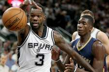 Dewayne Dedmon, reaching for a loose ball against New Orleans on Dec. 18, has been a solid contributor for the Spurs.