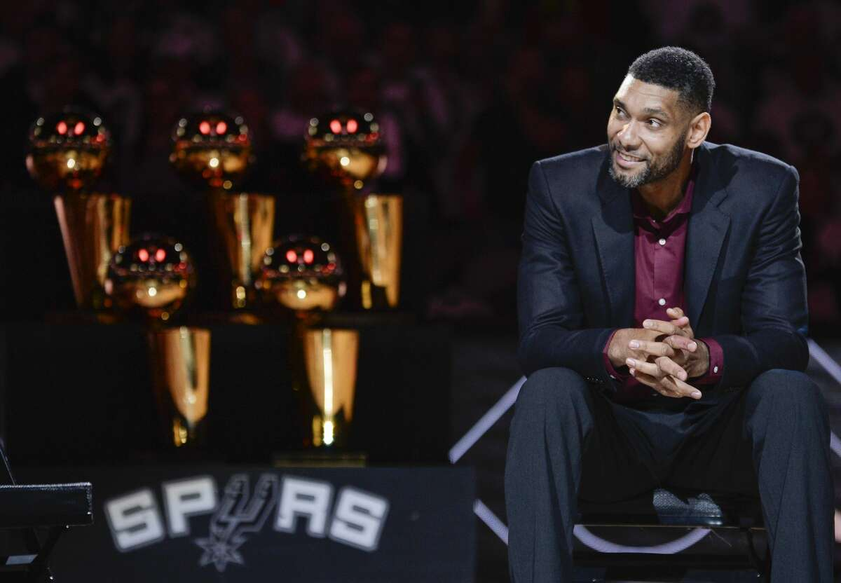 San Antonio Spurs' Tim Duncan listens while special guests speak about him during his jersey retirement ceremony, Sunday, Dec. 18, 2016, in San Antonio. (AP Photo/Darren Abate)