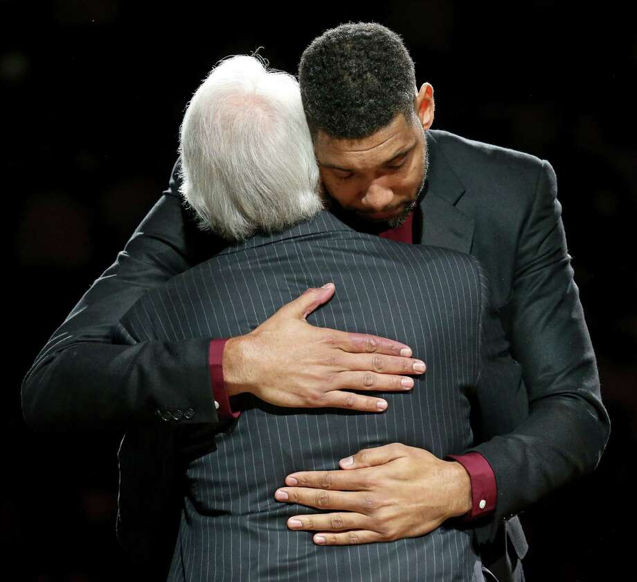 Former San Antonio Spurs player Tim Duncan hugs head coach Gregg Popovich during Duncan's No. 21 jersey retirement ceremony held after the game with the New Orleans Pelicans Sunday Dec. 18, 2016 at the AT&T Center. Photo: Edward A. Ornelas, Staff / San Antonio Express-News / © 2016 San Antonio Express-News