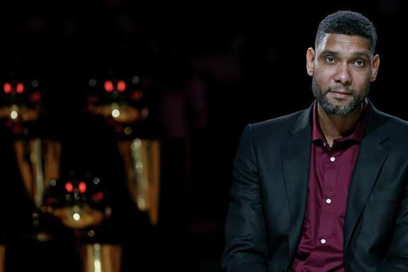 Former Spurs great Tim Duncan listens to speakers during his jersey retirement ceremony on Dec. 18, 2016 at the AT&T Center.