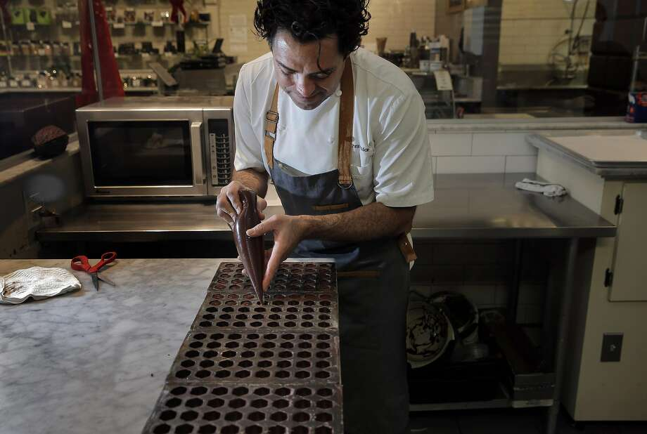 Chris Kollar pipes chocolate ganache into chocolate molds at Kollar Chocolates in Yountville. Photo: Carlos Avila Gonzalez, The Chronicle