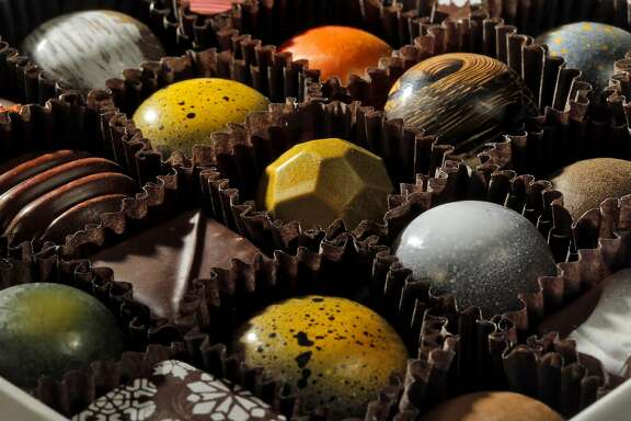 Various chocoalte truffles in a box made at Kollar Chocolates in Yountville, Calif., on Thursday, December 15, 2016. Chris Kollar is a self-taught chocolate maker who has a boutique chocolate shop specializing in hand-made chocolates The shop is filled with visually stunning chocolates and the chocolate is made on site.