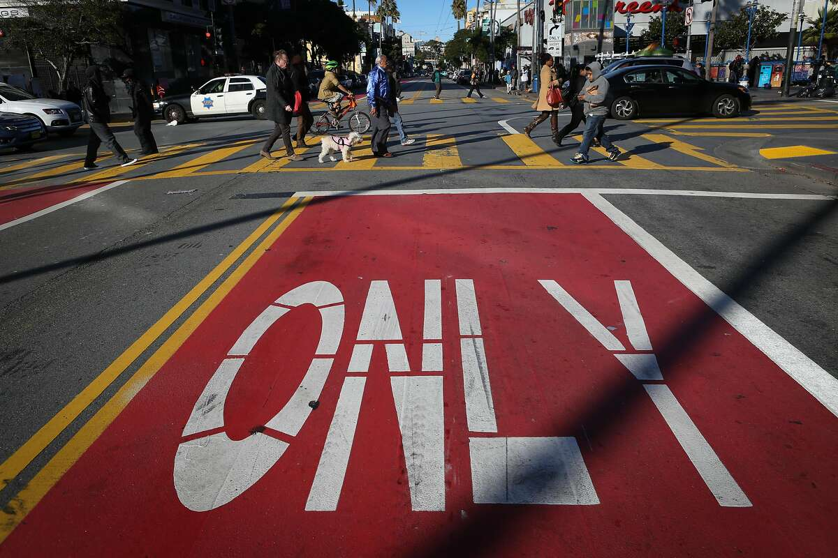 FILE--The red transit-only lanes seen at 16th and Mission St on Friday, Dec. 16 2016 in San Francisco. Muni recently approved new red lanes on Geary Boulevard between Stanyan and Gough streets.