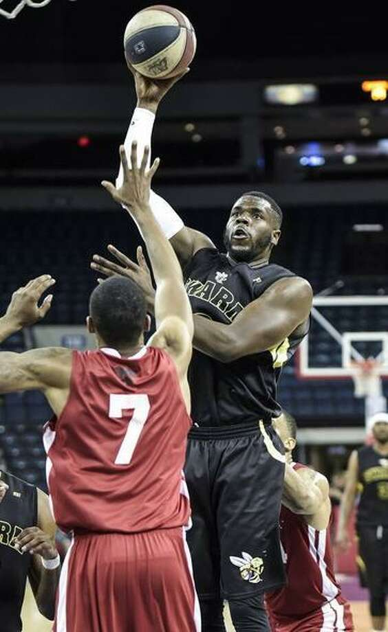 Playing his former team from a few years ago, Swarm center Tavien Rosemond recorded 11 points and nine rebounds in a season-opening loss to Austin Sunday. Photo: Danny Zaragoza / Laredo Morning Times File