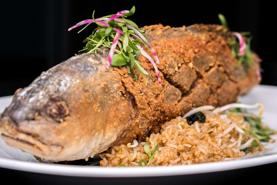 Kitchen 713 has moved to a new, larger location at 4601 Washington, opening Dec. 26. Shown: Thai fish (whole fried fish with smoked tomato-tamarind butter). Photo by Eddie Clarke.