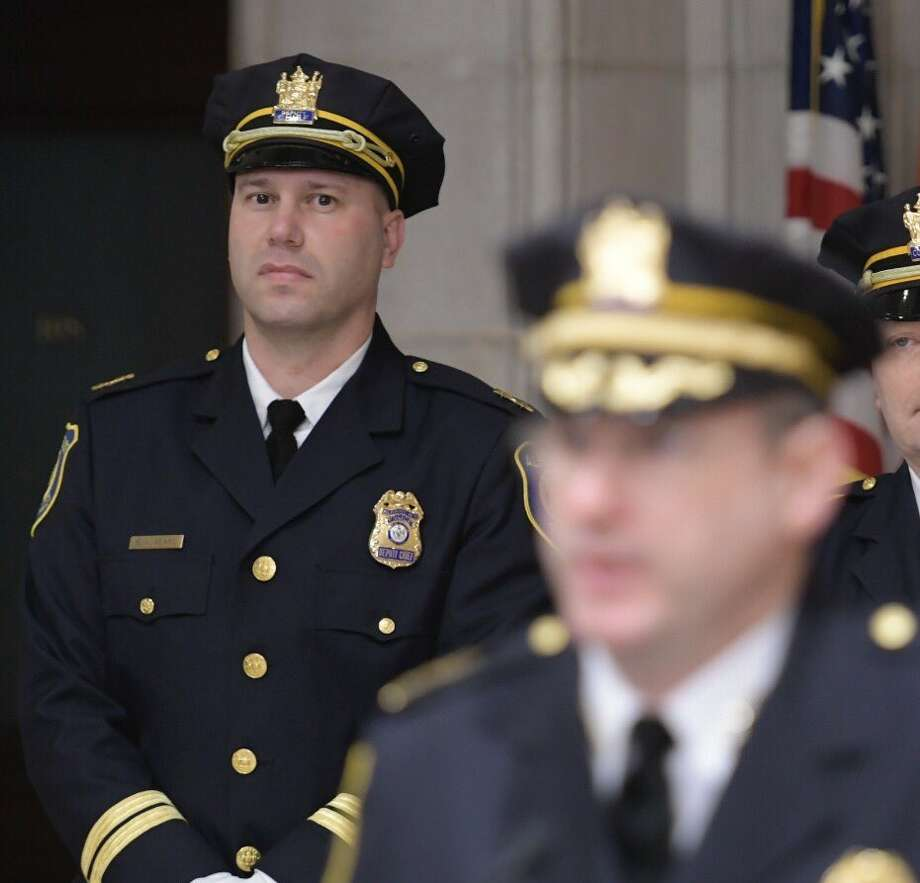 Deputy Albany Police Chief Robert Sears looks on as Police Chief Brendan Cox announces his retirement from the police department. Sears will take on day-to-day leadership of the department but Mayor Kathy Sheehan says she intends to mount a nationwide search for the next police chief. (Skip Dickstein / Times Union)
