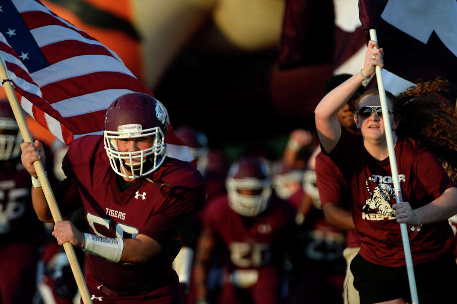 Silsbee lineman Jarred Watson leads the Silsbee Tigers onto the field before they take on the Newton Eagles at Tiger Stadium on Friday night.   Photo taken Friday 9/2/16 Ryan Pelham/The Enterprise Photo: Ryan Pelham / ©2016 The Beaumont Enterprise/Ryan Pelham