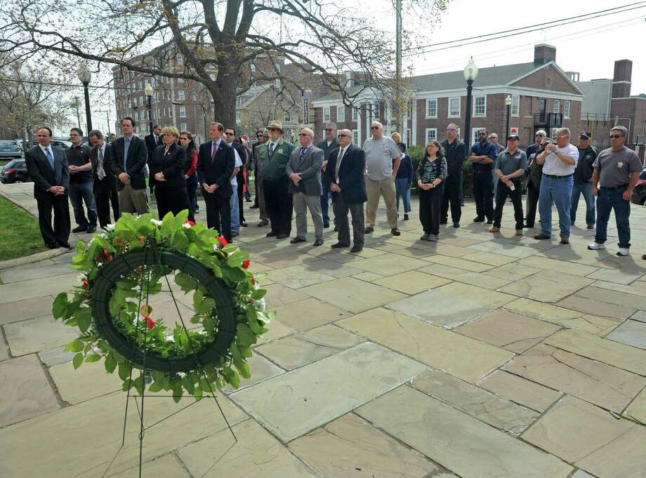 An April 2016 ceremony in Bridgeport, Conn. marked the 29th anniversary of the L'Ambiance Plaza collapse that killed 28 construction workers. In 2015, fatal workplace injuries in Connecticut rose by the sixth fastest rate nationally, with 44 people losing their lives from injuries sustained on the job. Photo: Cathy Zuraw / Hearst Connecticut Media / Connecticut Post