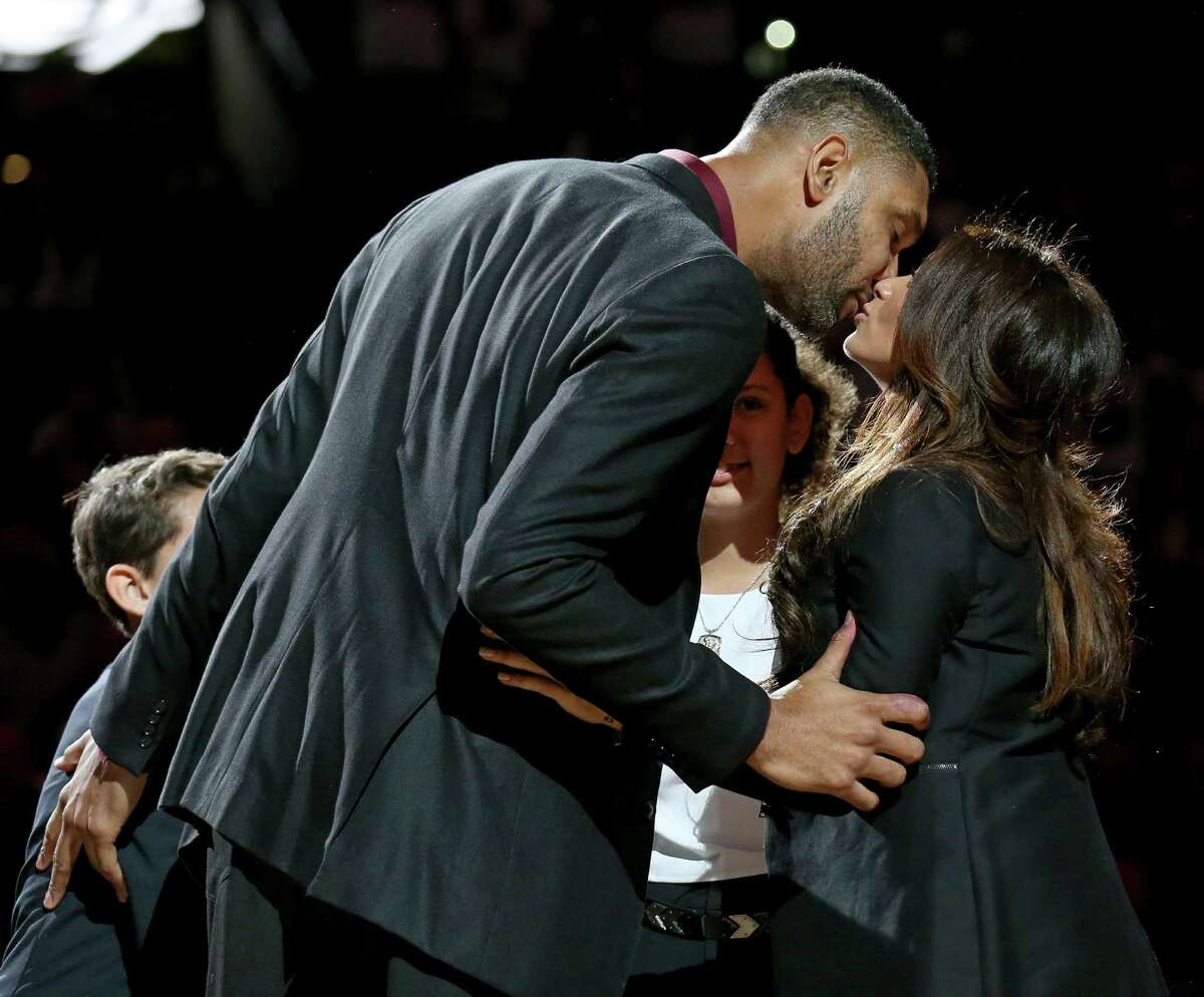 Former San Antonio Spurs player Tim Duncan kisses his girlfriend Vanessa Macias during Duncan's No. 21 jersey during the retirement ceremony held after the game with the New Orleans Pelicans Sunday Dec. 18, 2016 at the AT&T Center.