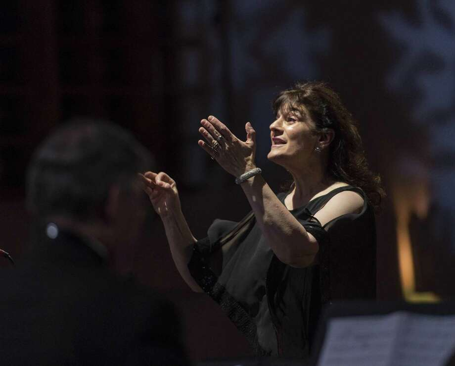 """Mary Bozzuti-Higgins directs the choir during the """"Arise and Shine"""" Christmas Concert held at the Klein Memorial Auditorium, Bridgeport, CT. Sunday, December 18, 2016. Photo: Mark Conrad / For Hearst Connecticut Media / ©Mark F Conrad"""