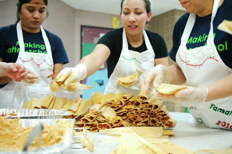 Josefina Marban, left, Adela Quiroga and Sonia Morales stack tamales during Tamalada 2016, a holiday tamale-making party at South Houston Elementary School on Dec. 16. It took 30 pounds of masa to make 720 tamales.KEEP CLICKING TO SEE MORE OF TEXAS' BEST HOLIDAY TRADITIONS Photo: Kirk Sides / © 2016 Kirk Sides / Houston Community Newspapers