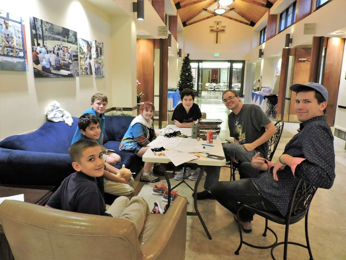 """Children lead in a role-playing game of """"Dungeons and Dragons"""" at an afterschool program at St. Thomas the Apostle Episcopal School."""