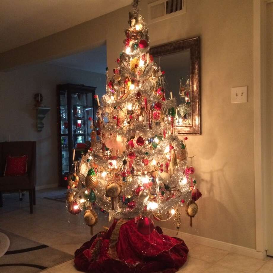 The Ringh family of Houston has been celebrating Christmas for a century with the same tree $11 artificial tree bought at Eiband's Department Store in Galveston in 1910. Photo: Submitted Photo