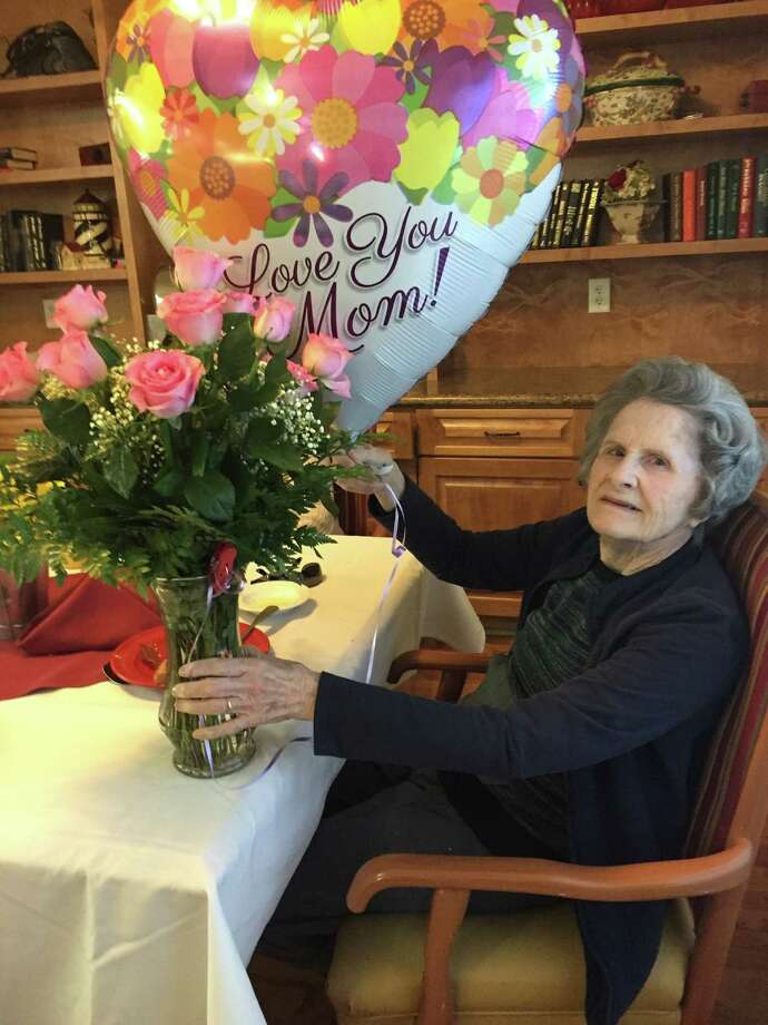 84-year-old Mary Sue Ferguson, a Parkway Place resident in the memory care area, celebrates birthday with her family at the senior living community. Photo: Parkway Place