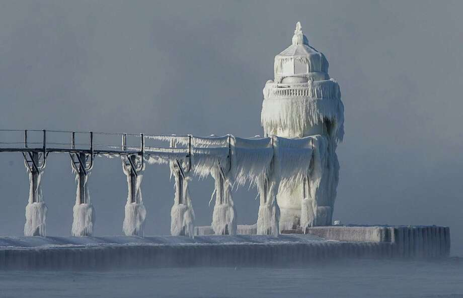 Extreme cold conditions cause ice accretions to cover the St. Joseph lighthouse and pier, on the southeastern shoreline of Lake Michigan, on Monday, Dec. 19, 2016, in St. Joseph, Mich. Keeping going for a historic look at some of the iciest days in Houston history.  Photo: Robert Franklin, AP / South Bend Tribune