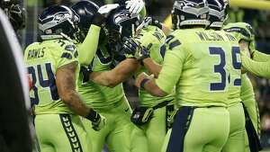 SEATTLE, WA - DECEMBER 15:  Teammates celebrate with tight end Luke Willson #82 of the Seattle Seahawks after he scored a touchdown against the Los Angeles Rams at CenturyLink Field on December 15, 2016 in Seattle, Washington.  (Photo by Otto Greule Jr/Getty Images)