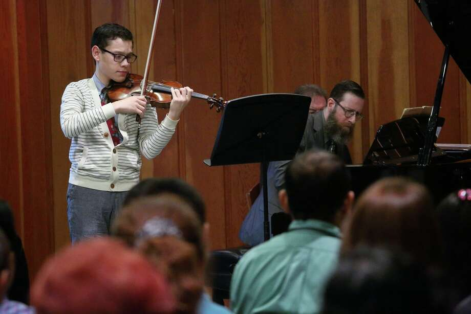 """Violinist, Gabriel Maffuz-Anker performs at the Music Doing Good annual scholarship concert. Photo: Jay Ford / """""""""""