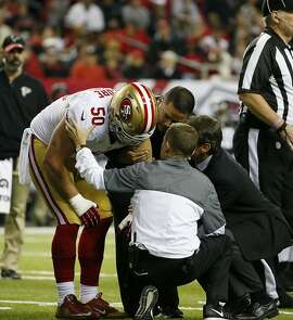 San Francisco 49ers inside linebacker Nick Bellore (50) is attended to by staff after injury against the Atlanta Falcons during the first half of an NFL football game, Sunday, Dec. 18, 2016, in Atlanta. (AP Photo/Butch Dill)