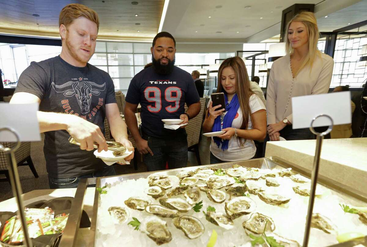 Chris Guyton, left, Ethan West, Cassandra West, and Caiti, right, are shown at Third Coast, 6550 Bertner Ave., during Brunch Off, a preview party for the Taste of the NFL, one of the Super Bowl's major fundraisers.