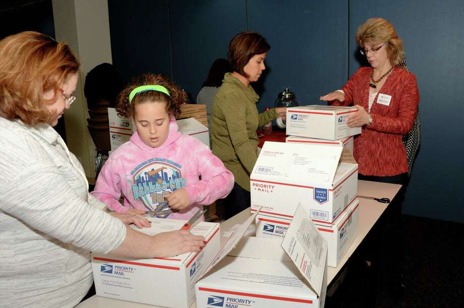 """Volunteers prepare care packages for U.S. military service members who are currently deployed as part of the American Red Cross Houston Chapter """"Holiday for Heroes"""" program on Thursday December 15, 2016 Houston, TX. Photo: Craig Moseley, Staff / ©2016 Houston Chronicle"""