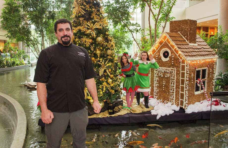 Roland's Bakery and Omni Executive Chef Angel Rodriguez built and decorated a giant gingerbread house which will be on display through Jan. 2 at Omni Houston Hotel at Westside. Photo: Omni Houston Hotel At Westside
