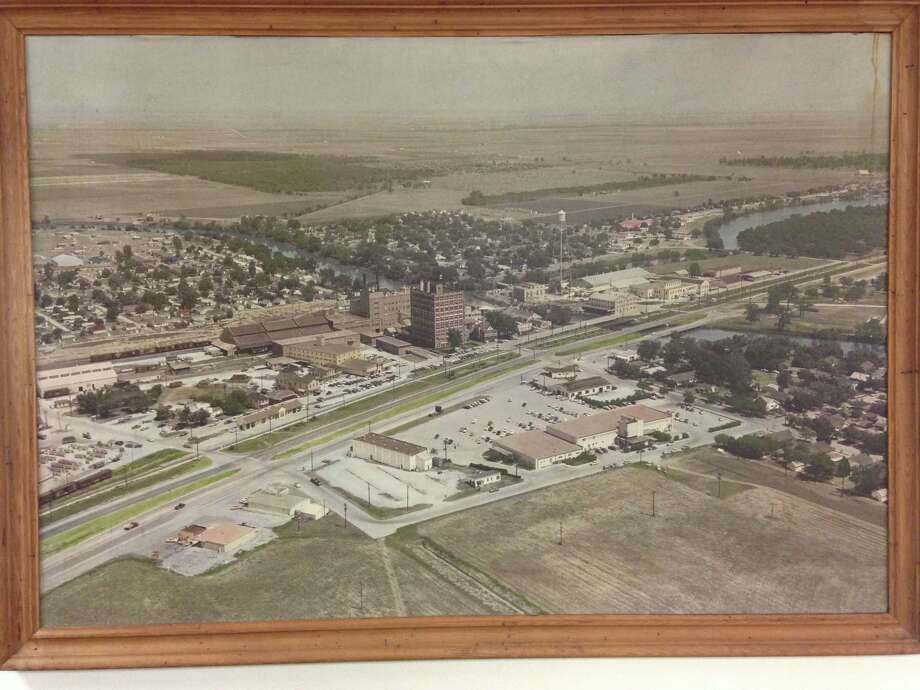 This aerial photograph take in 1956 circa is of Sugar Land when it was still a company town owned by Imperial Sugar. The picture was taken from the south/southwest. This picture along will other large pictures and drawings will be a part of an upcoming preservation project. Photo: Sugar Land Heritage Foundation