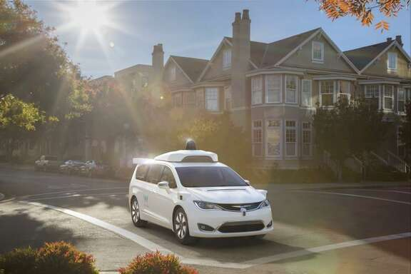 A Chrysler Pacifica minivan, modified to use Waymo's self-driving technology. Waymo is the new name for Google's self-driving car division.