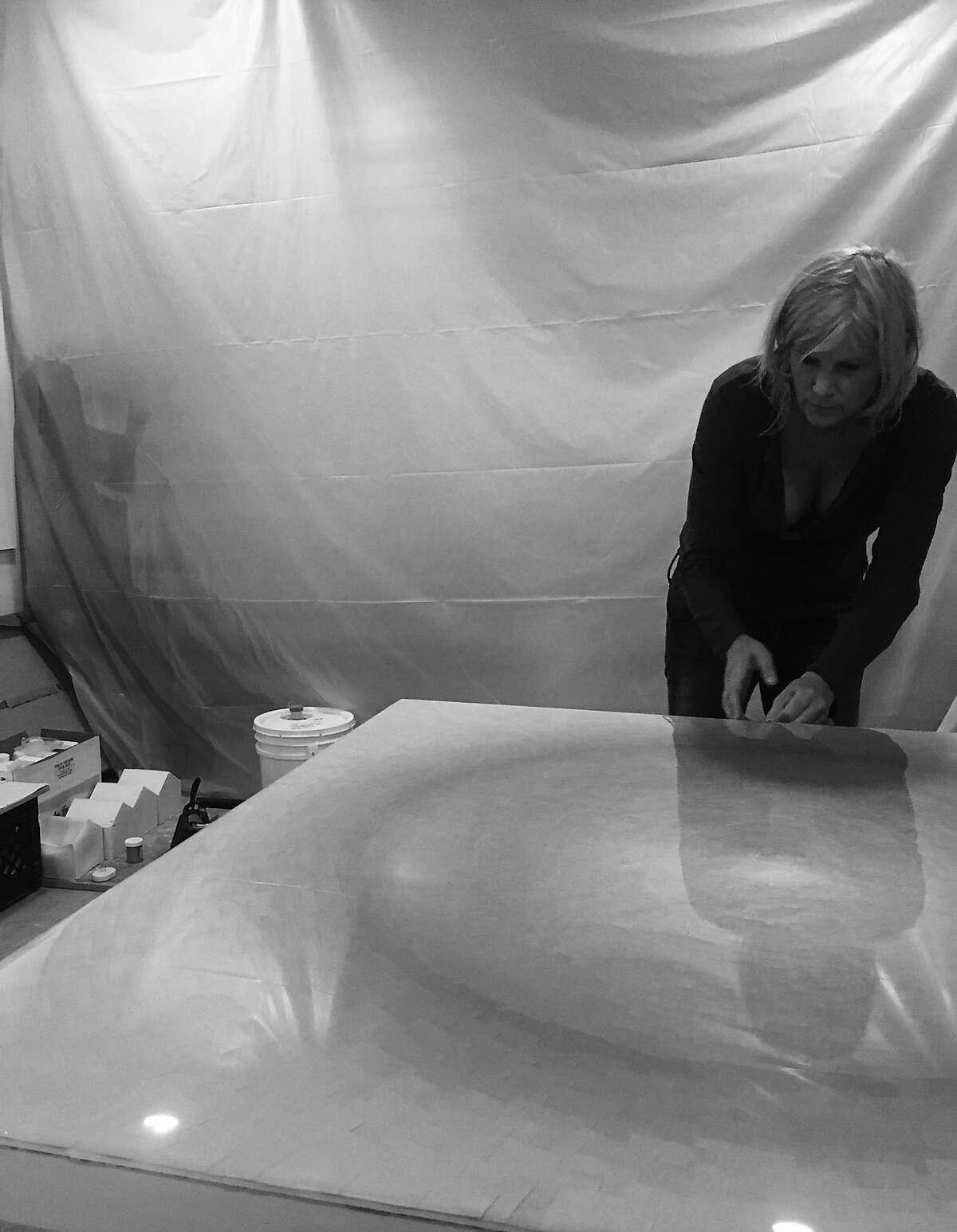 Lisa Bartleson constructing a sphere in her Petaluma studio